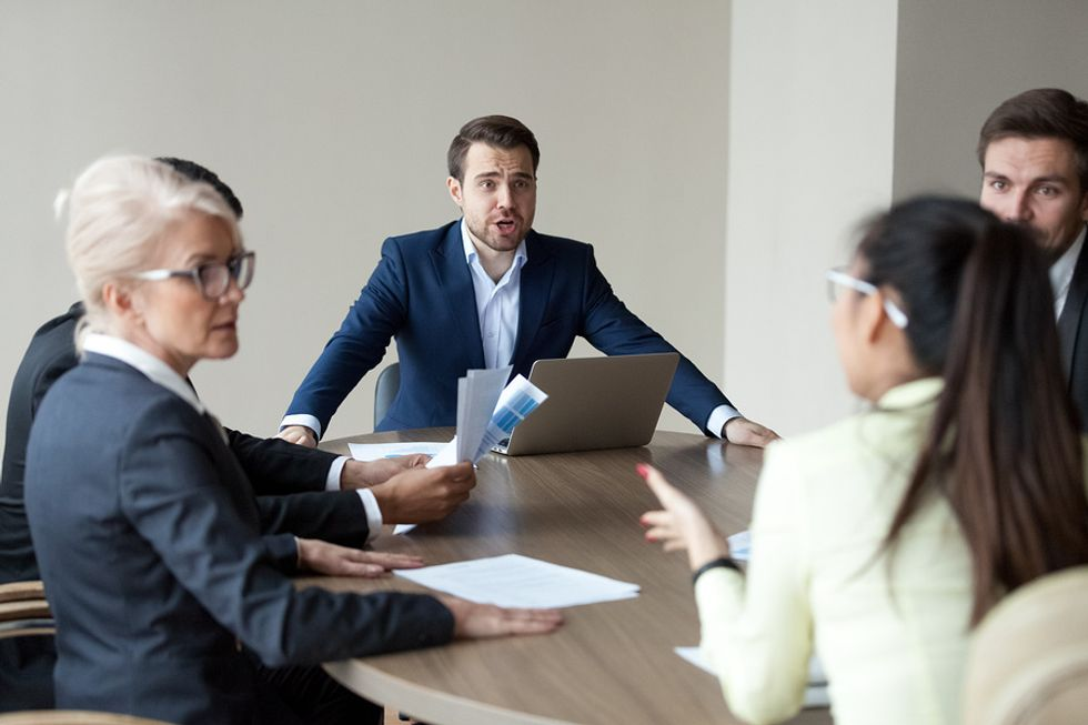 Two executives argue during a meeting