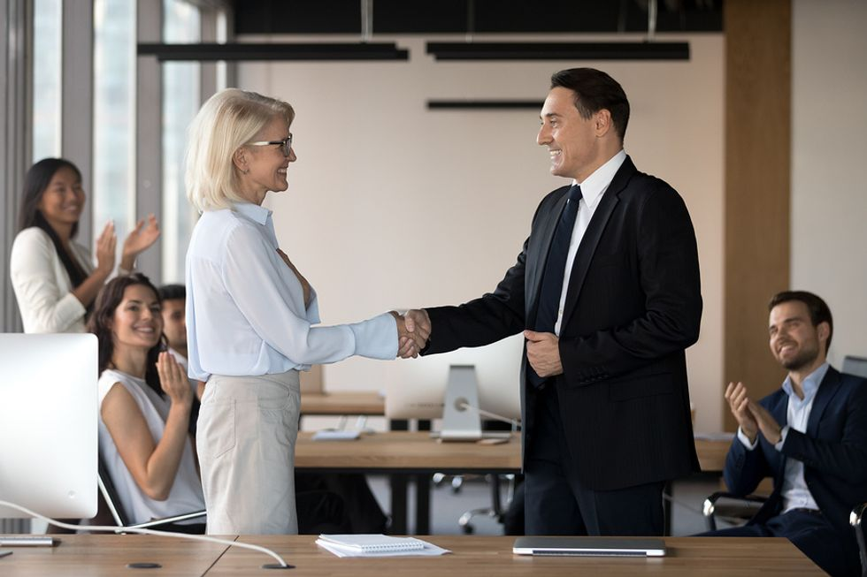 Employees congratulate their new CEO on his executive job
