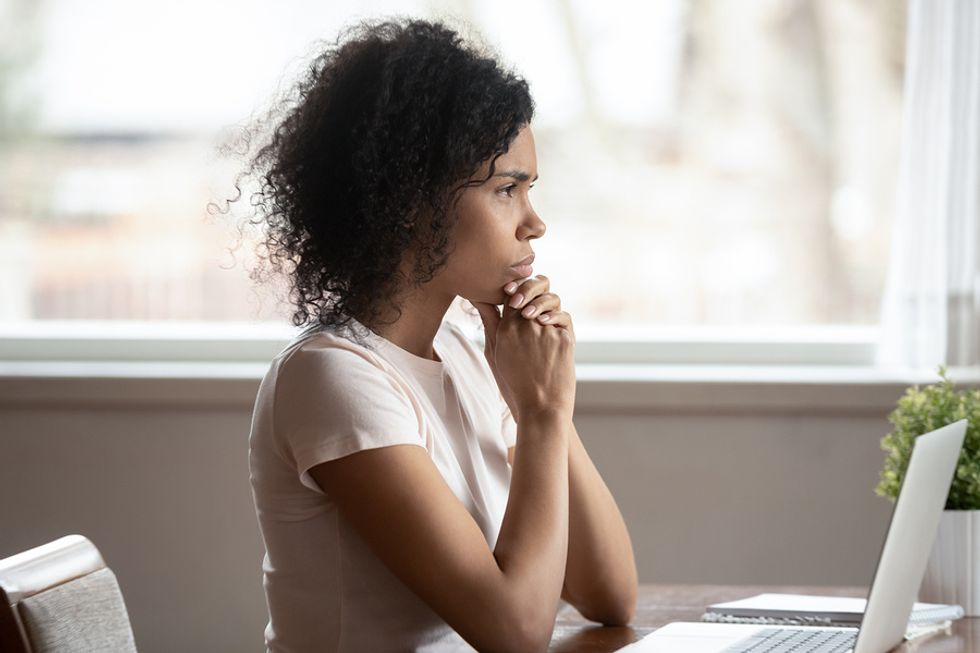 Professional woman thinking about how she can be better at self-promotion