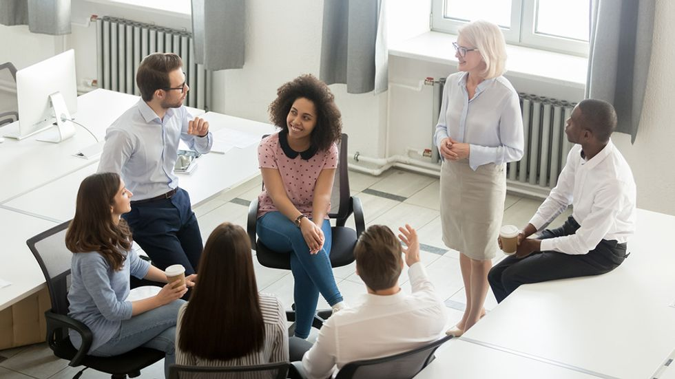 Company with great workplace culture has a meeting to discuss employee performance