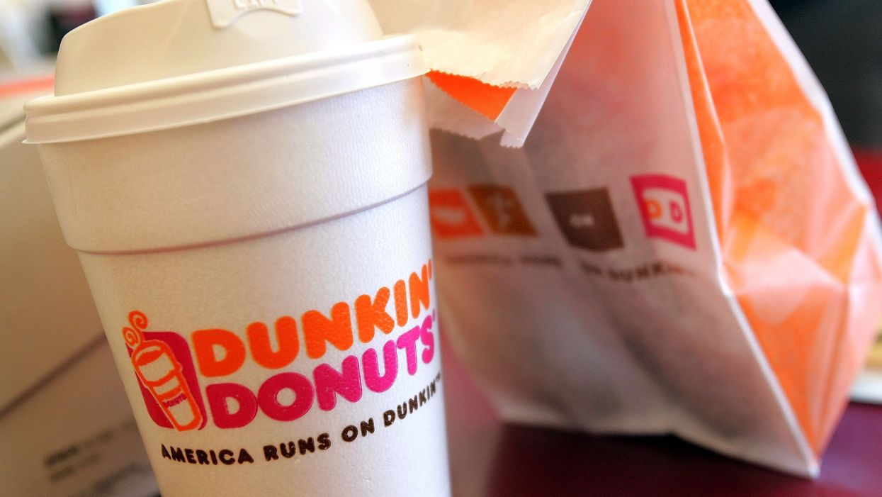 Police officer sues Dunkin' Donuts after employee spit into his coffee. The employee insists it wasn't because he was a cop.