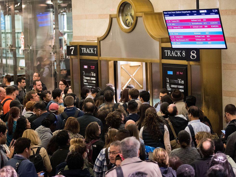 Passengers rush toward a New Jersey Transit trains platform during rusPenn Station New York City NYC rush hour