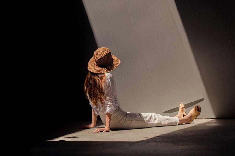 https://www.pexels.com/photo/woman-sitting-on-ground-2868847/