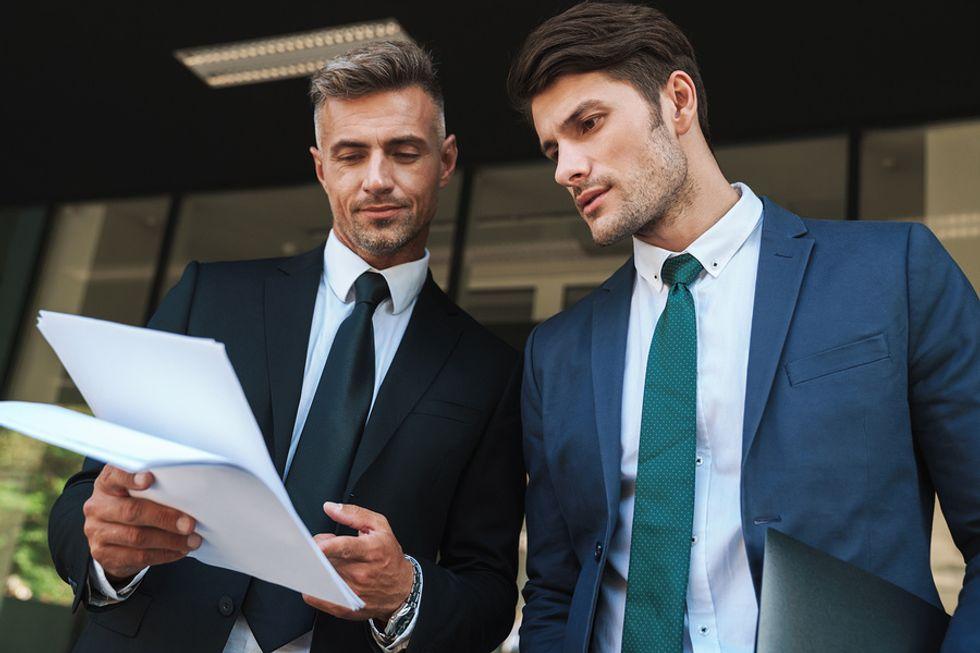 Gen X manager explains a report to a millennial employee