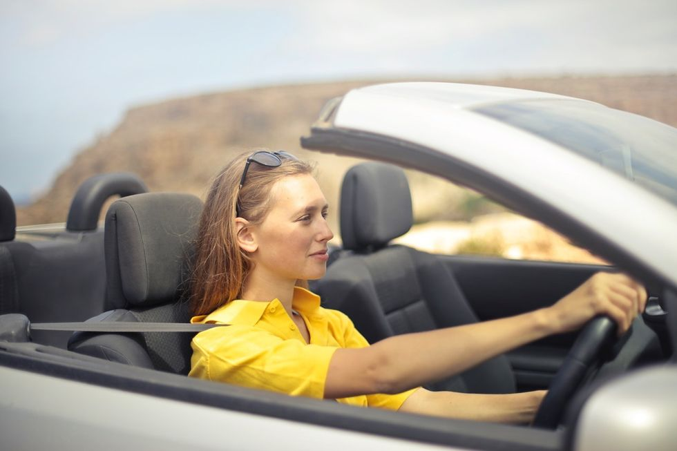 Woman driving thinking about her new job offer