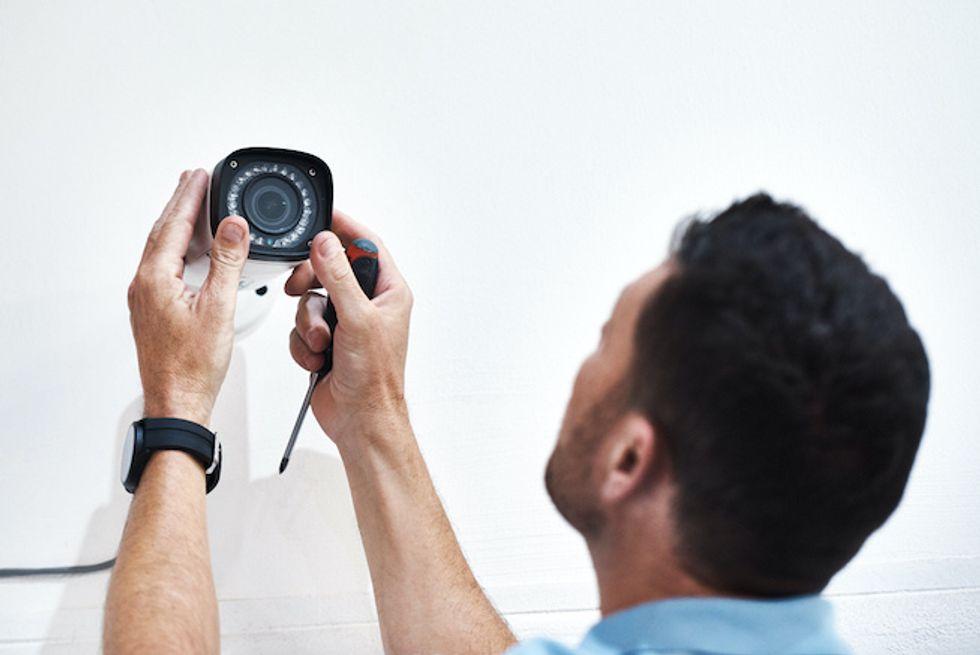 Someone installing a smart video camera