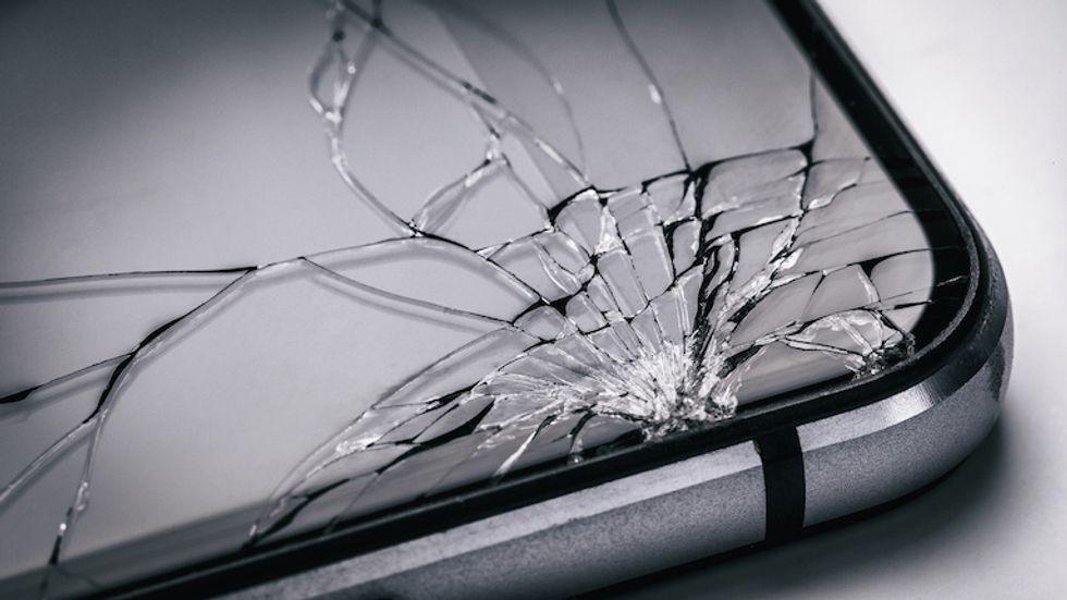 Broken mobile phone screen close up.  Weak glass in modern gadgets