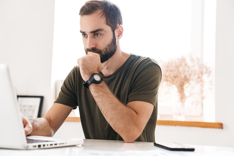 Man optimizing his LinkedIn profile to stand out to recruiters