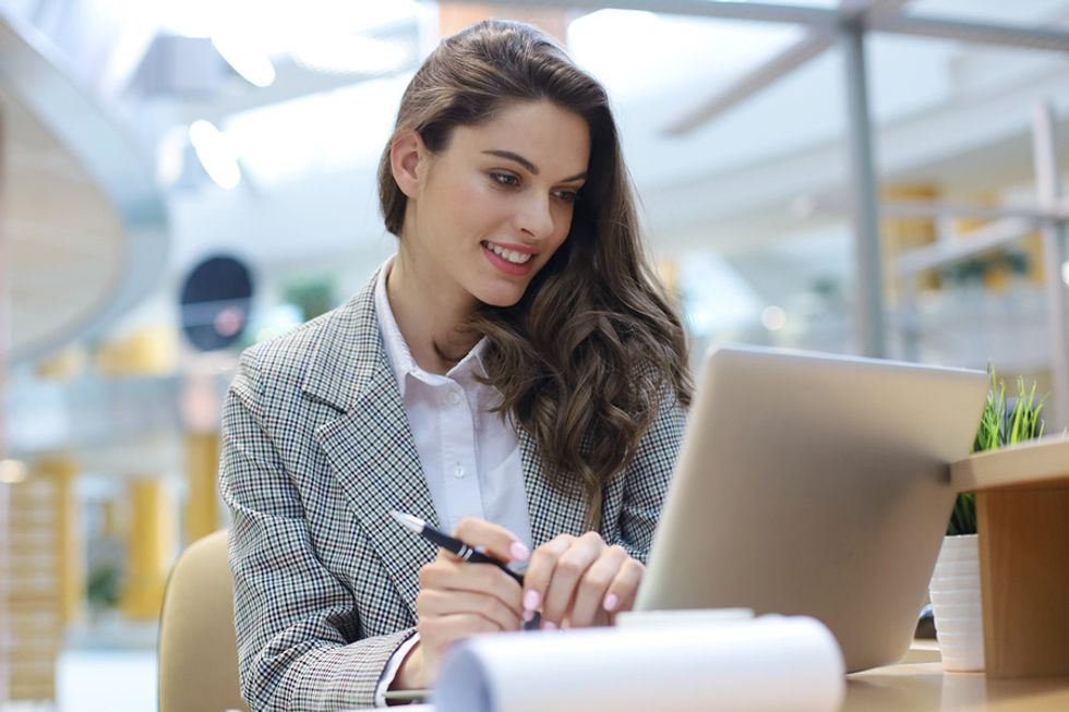 Professional woman creating achievable career goals without fearing failure