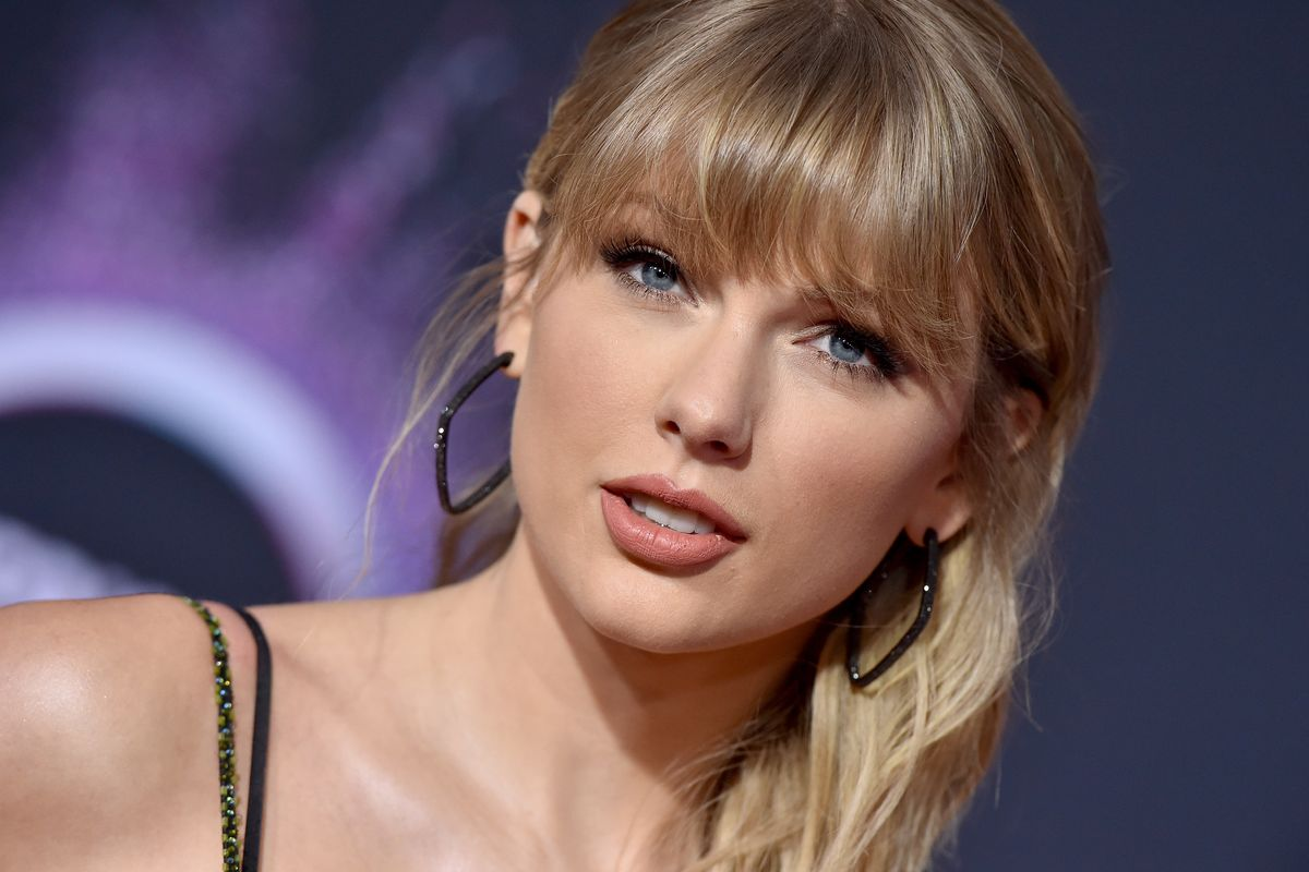 Taylor Swift Wears Vintage Chanel on British 'Vogue' Cover
