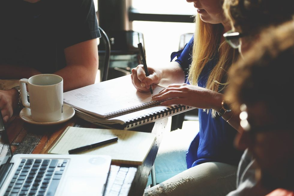 https://www.pexels.com/photo/people-coffee-meeting-team-7096/