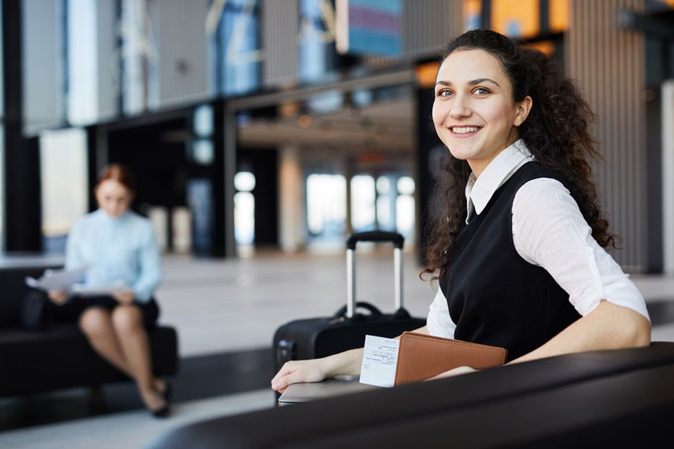 Woman waiting in the airport with a universal charger kit