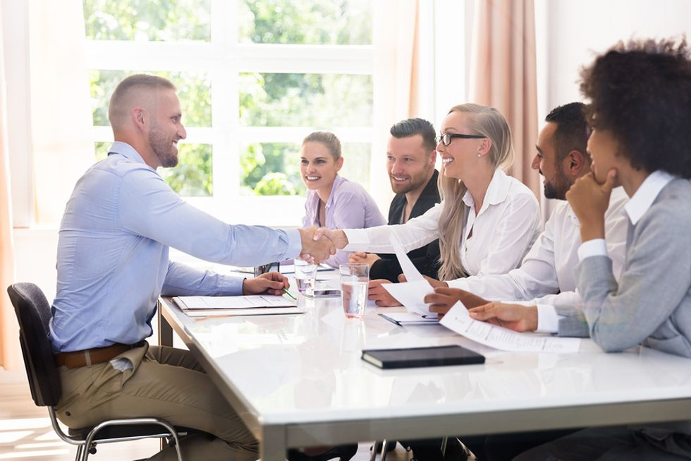 Job applicant introduces himself to a panel of interviewers