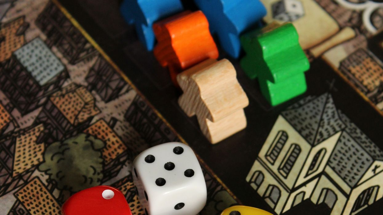 Assorted board game piece and dice