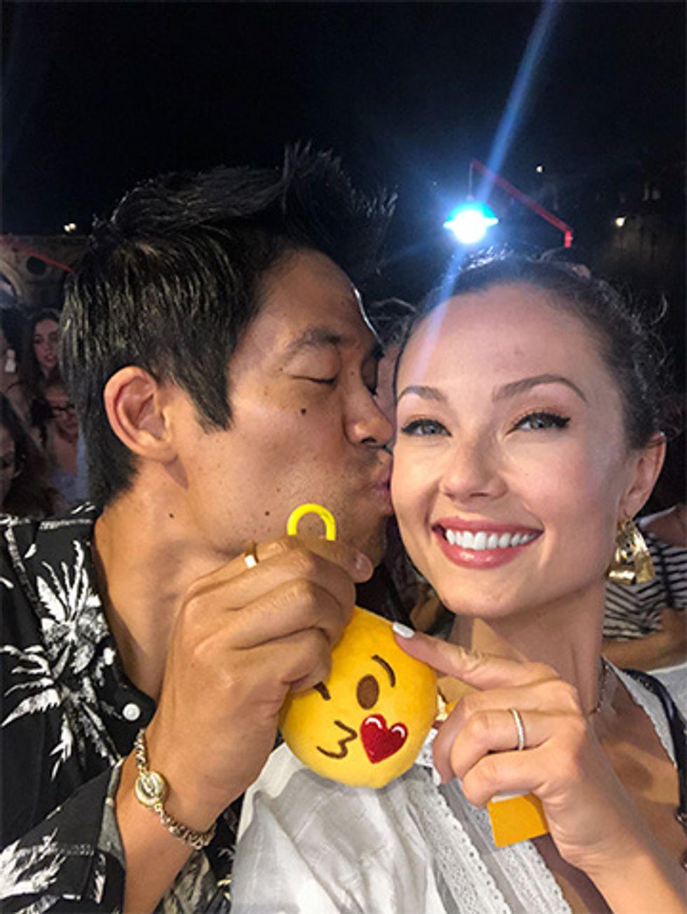 Actor David Lim kissing wife Marketa Kazdova on the cheek while on their honeymoon.