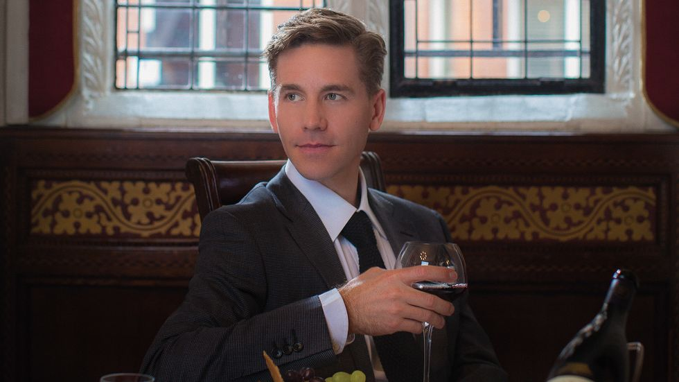 "Brian Dietzen ""Jimmy Palmer"" of NCIS holding a glass of wine and reflecting."