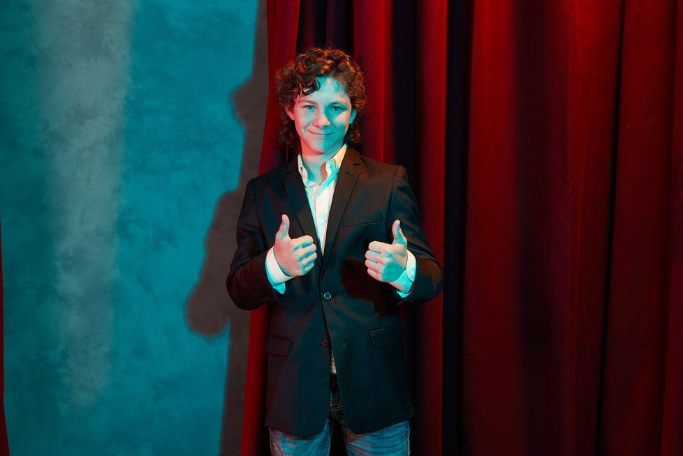 Actor Montana Jordan of TV show Young Sheldon giving two thumbs up.