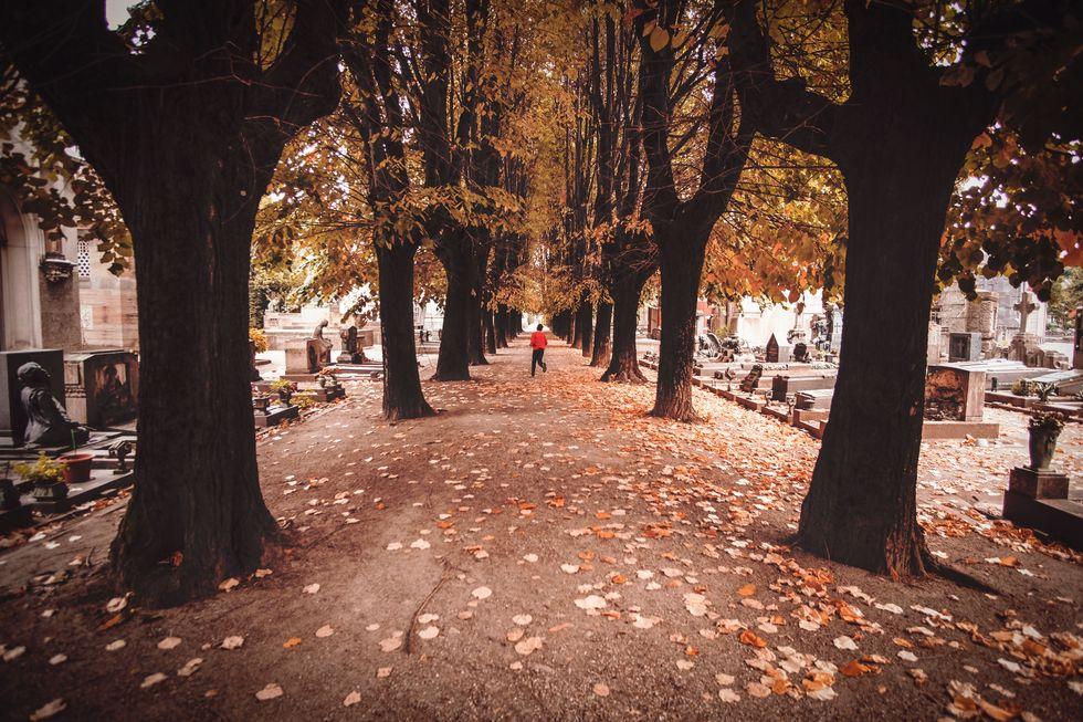 Person running through graveyard