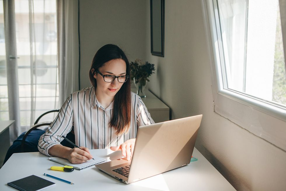 Professional woman keeps her New Year's resolution by working on her career
