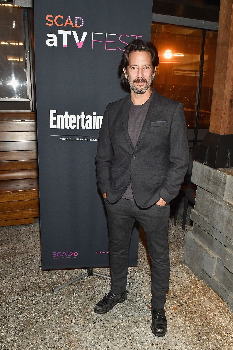 Henry Ian Cusick attends the SCAD aTVfest and Entertainment Weekly party in Atlanta, Georgia.