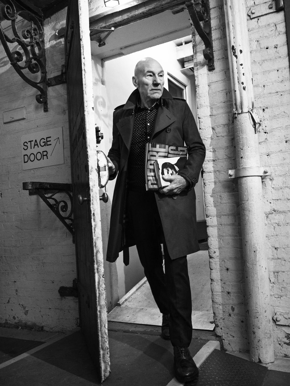 Black and white portrait of Sir Patrick Stewart exiting stage door of a theater.