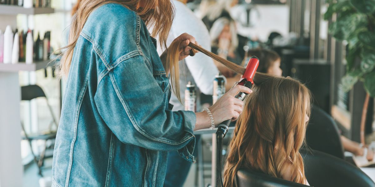 8 stylist-backed tips to keep your hair healthy + frizz-free this winter