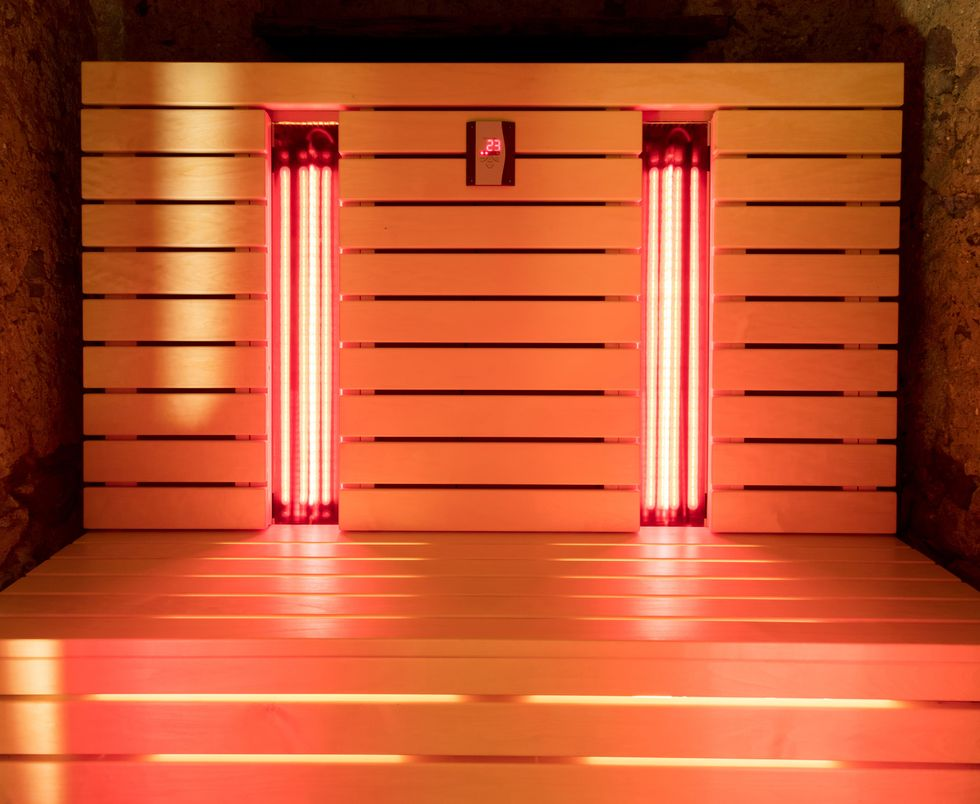 Interior of an infrared sauna, with glowing red lights