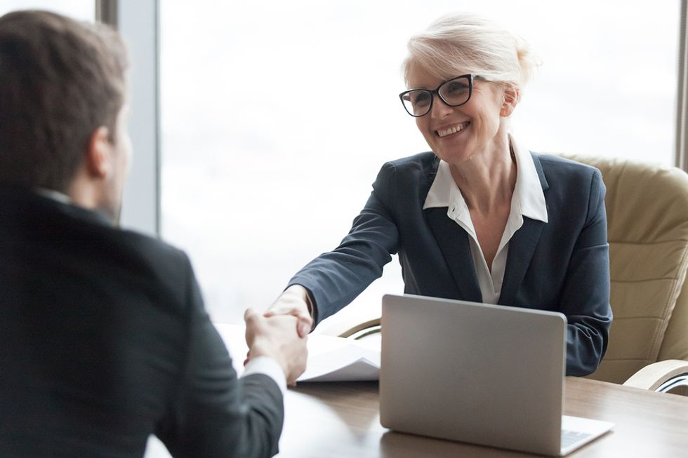 Manager thinking of hiring job candidate for her high-performance team