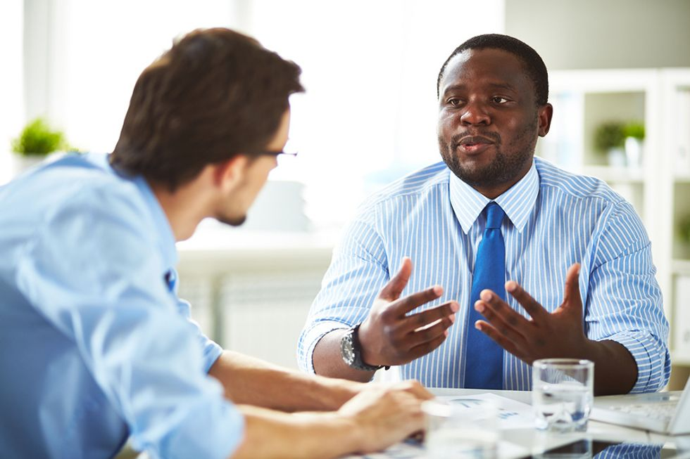 """Job candidate answers the question, """"Tell me about yourself,"""" during an interview for a marketing position"""