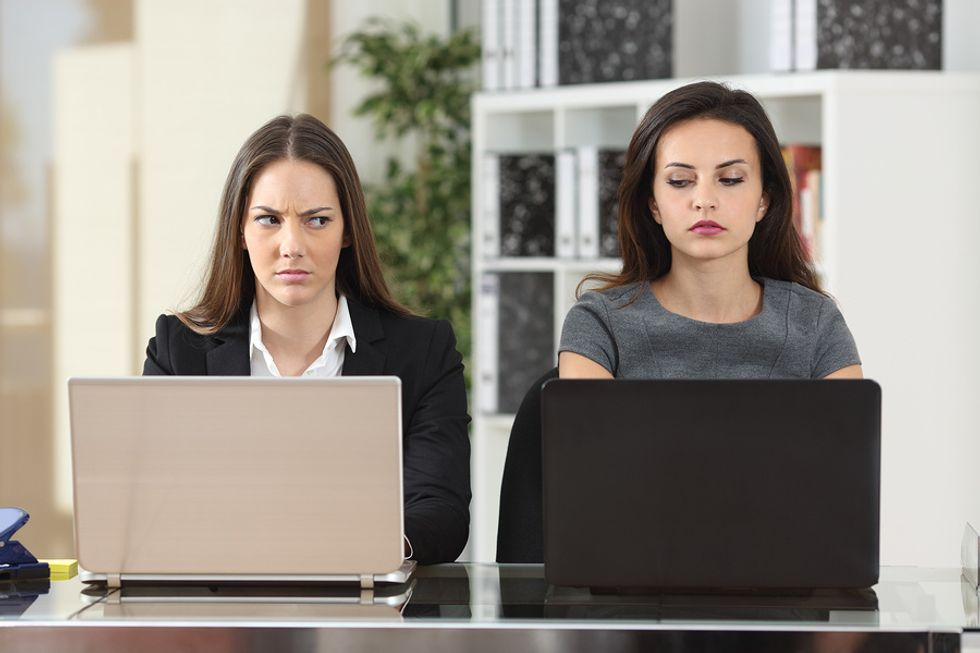 Woman sits next to her annoying co-worker