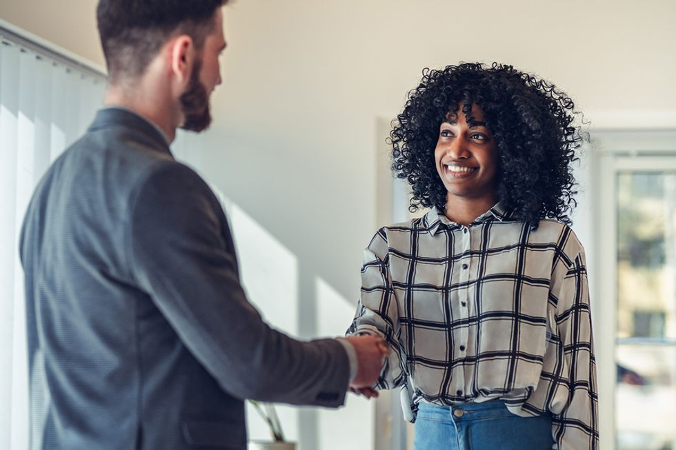 Professional woman thanks her boss for being her reference
