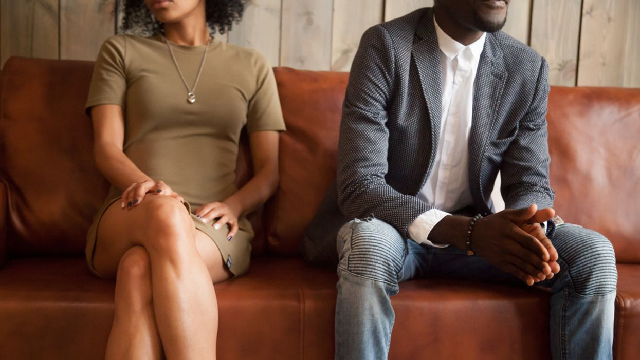 man and woman sitting apart on a couch tense relationship problems