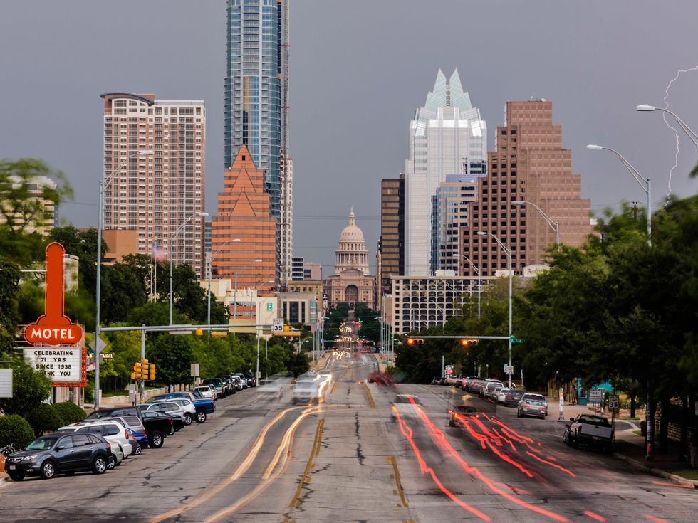 Blurred motion view of cars driving in Austin cityscape, Texas, United States
