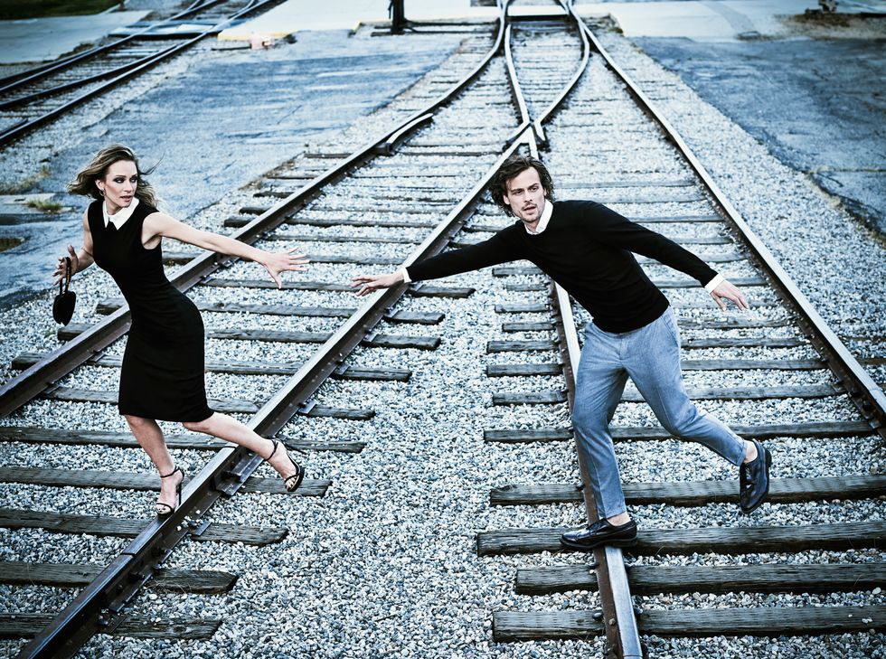 A.J. Cook and Matthew Gray Gubler of Criminal Minds crossing train tracks.