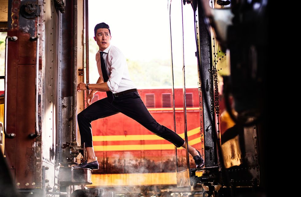 Daniel Henney of Criminal Minds in between train cars.