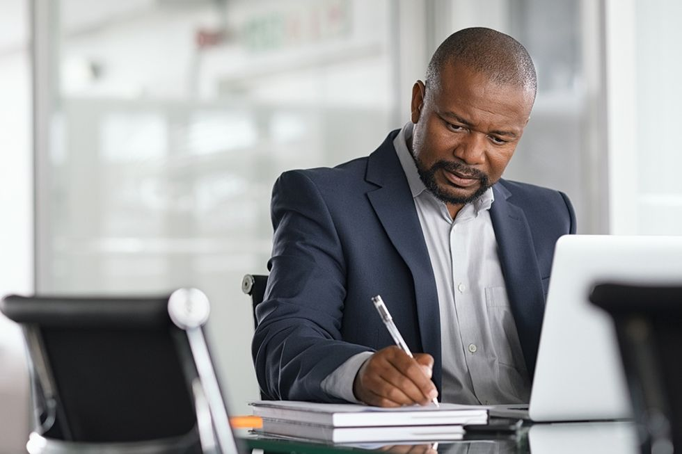Professional man thinking about a time he went above and beyond at work