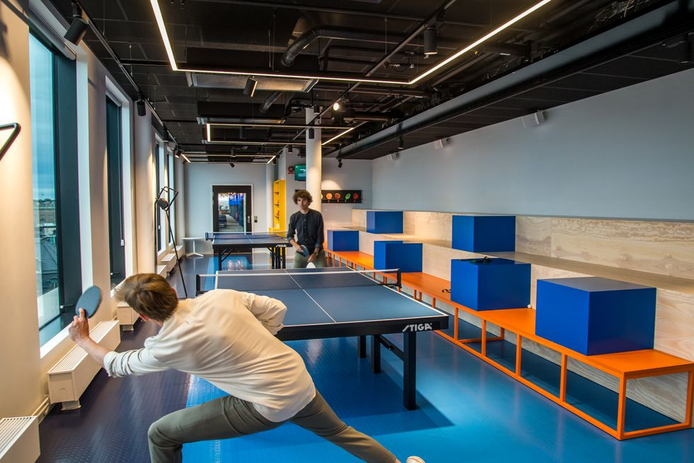 Employees play ping pong at Spotify's Stockholm, Sweden headquarters.