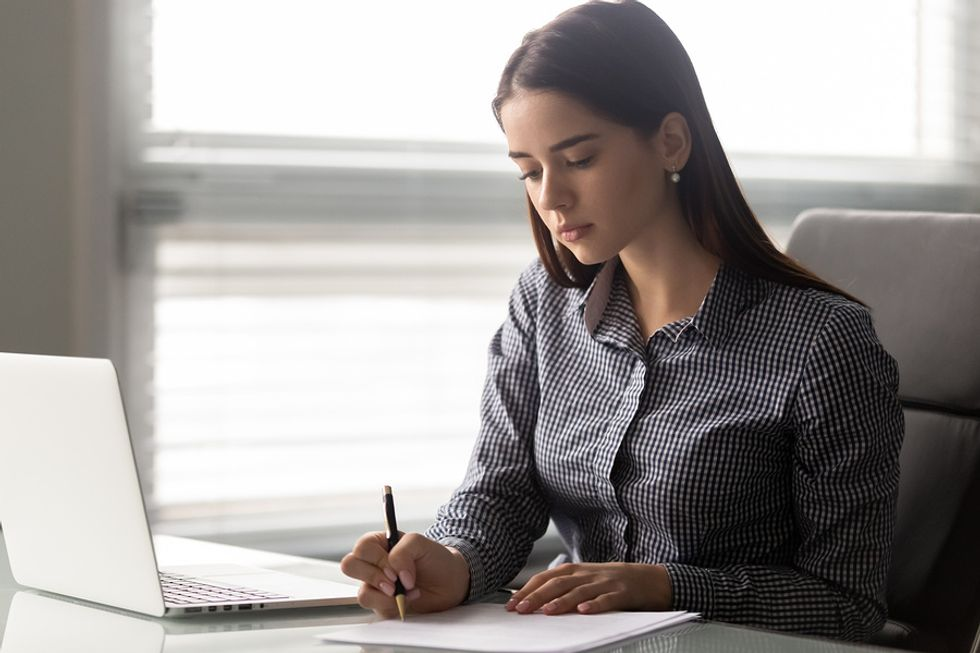 Woman taking note of all her transferable skills