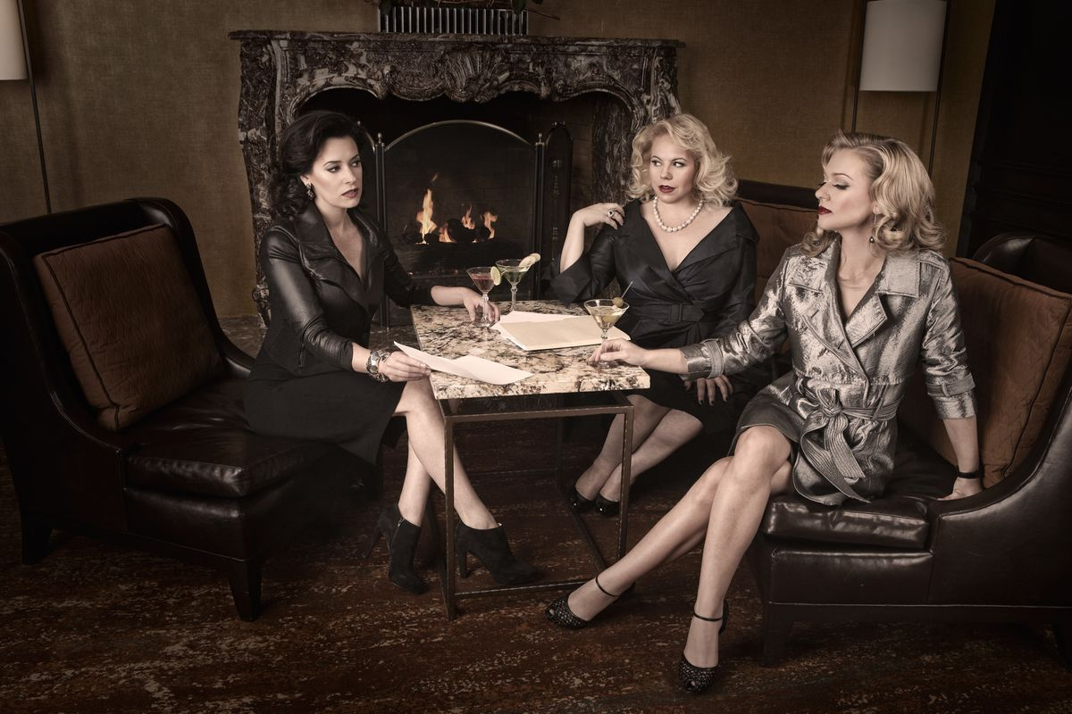 Paget Brewster, Kirsten Vangsness, and A.J. Cook having martinis at a hotel bar.