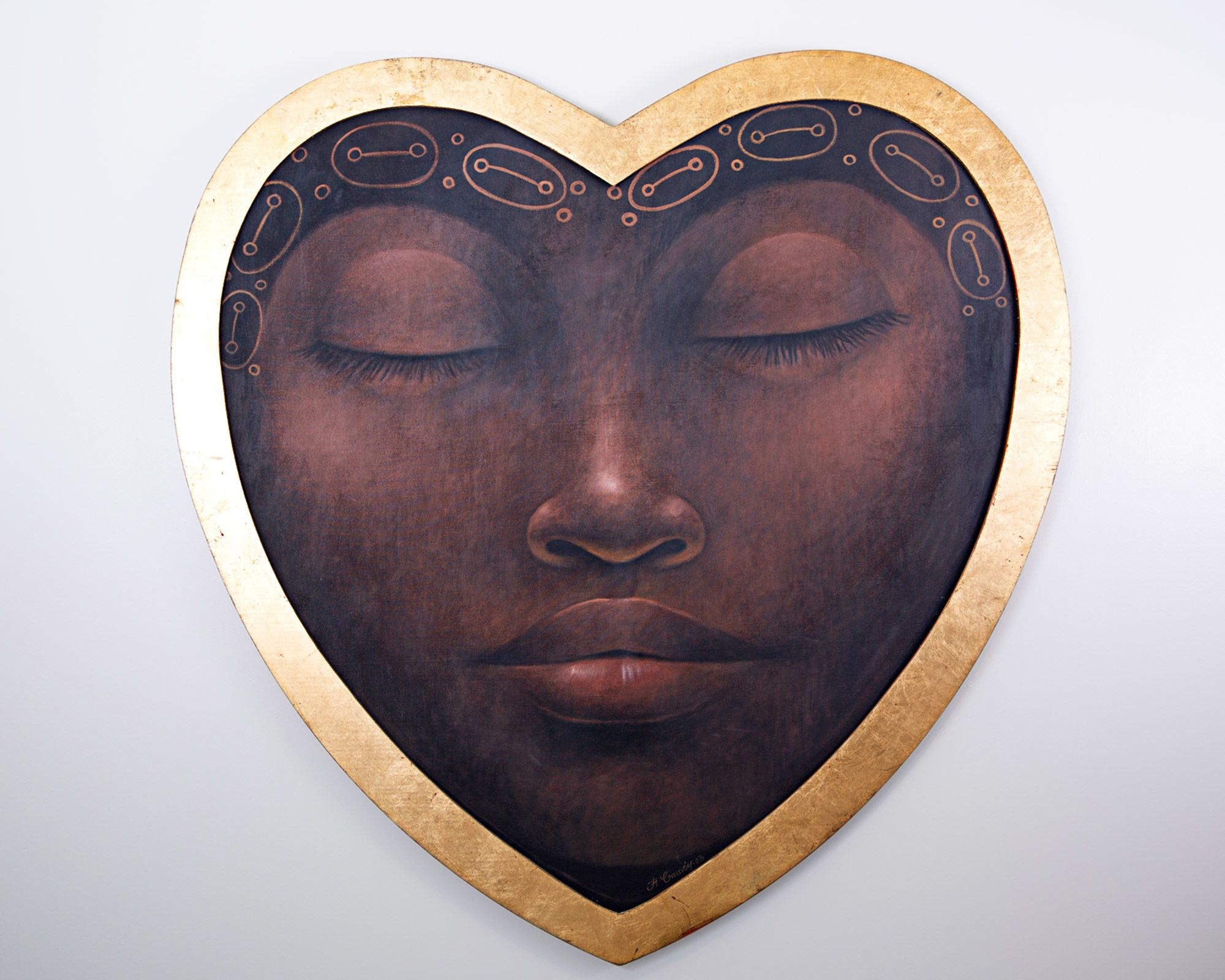 Painting of heart-shaped quasi-mask showing a woman in serene slumber.