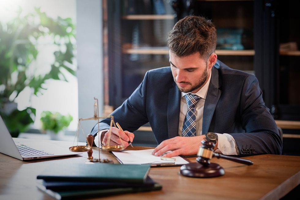 A detail-oriented lawyer signs a document