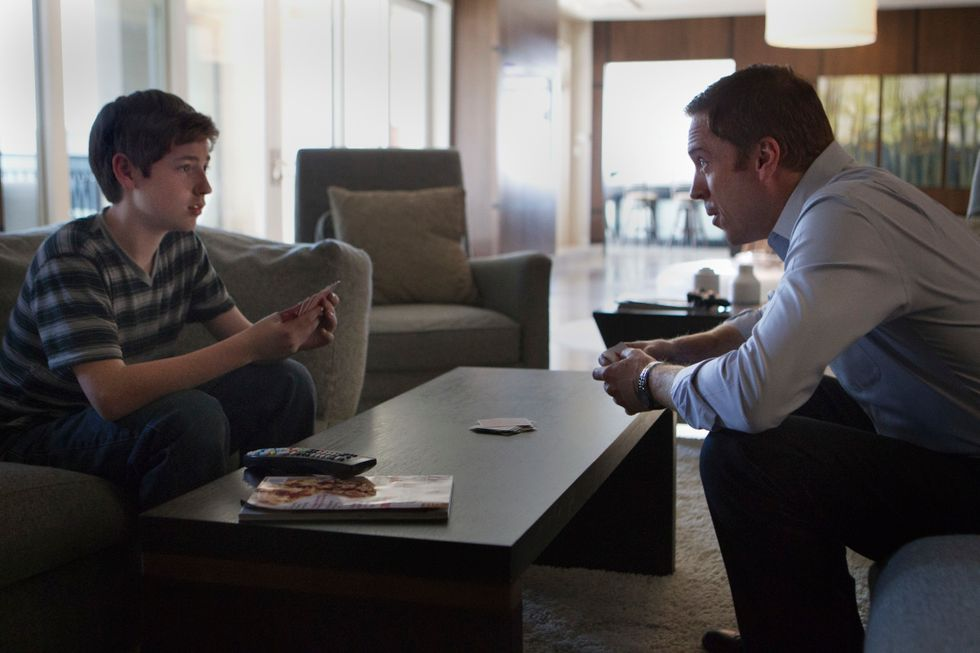 Jackson Pace and Damian Lewis playing cards.