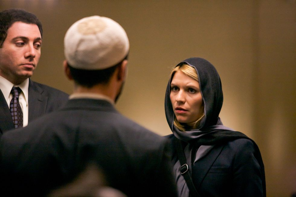 Claire Danes in a head scarf in the Middle East.