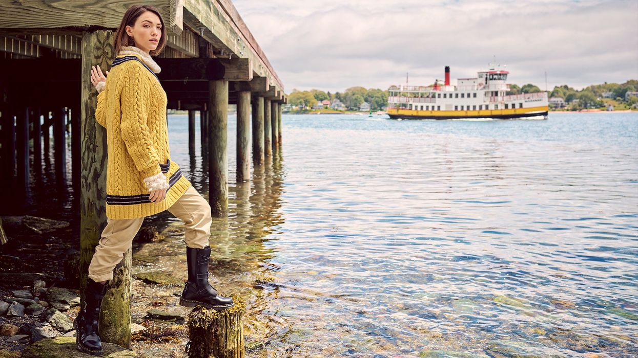 Violett Beane standing at the foot of a pier in Maine.