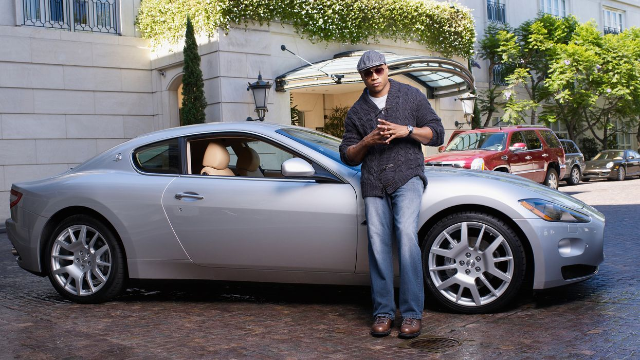 LL COOL J standing in front of a porsche.