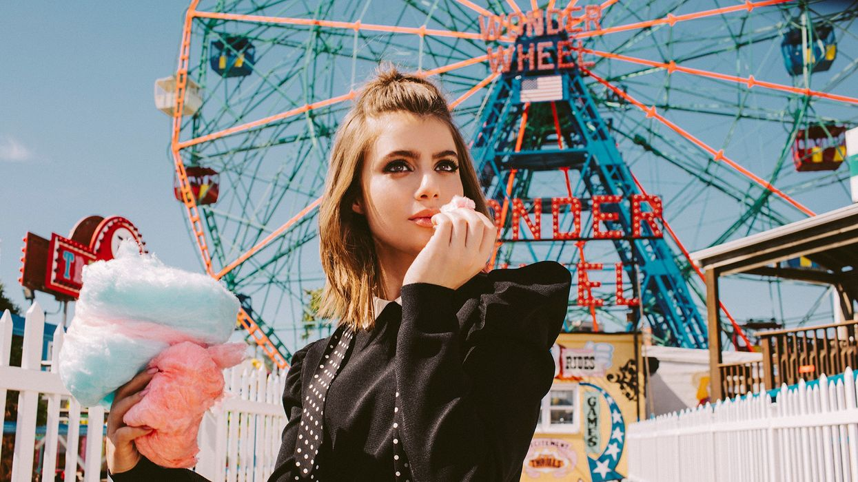 Sami Gayle in front the Ferries Wheel in Coney Island.