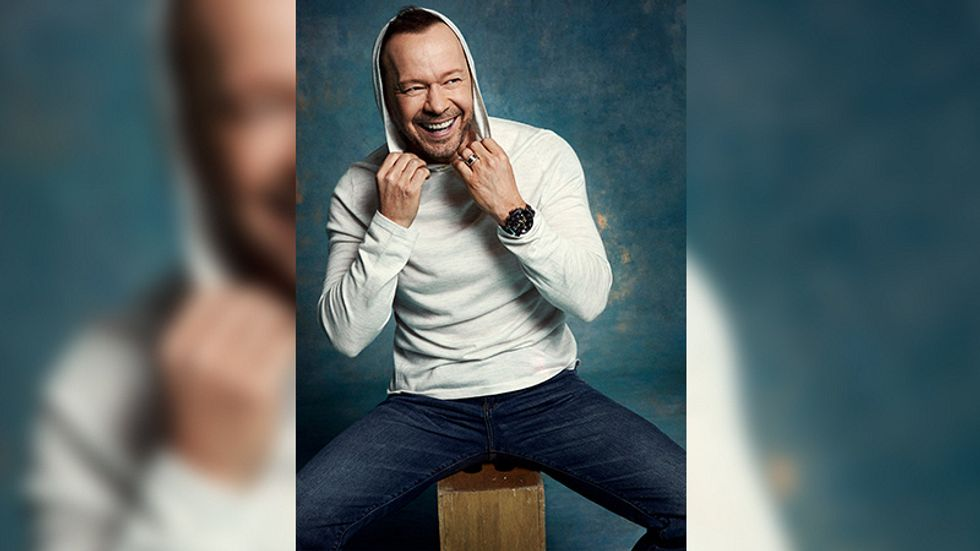 Donnie Wahlberg laughing in a hoodie