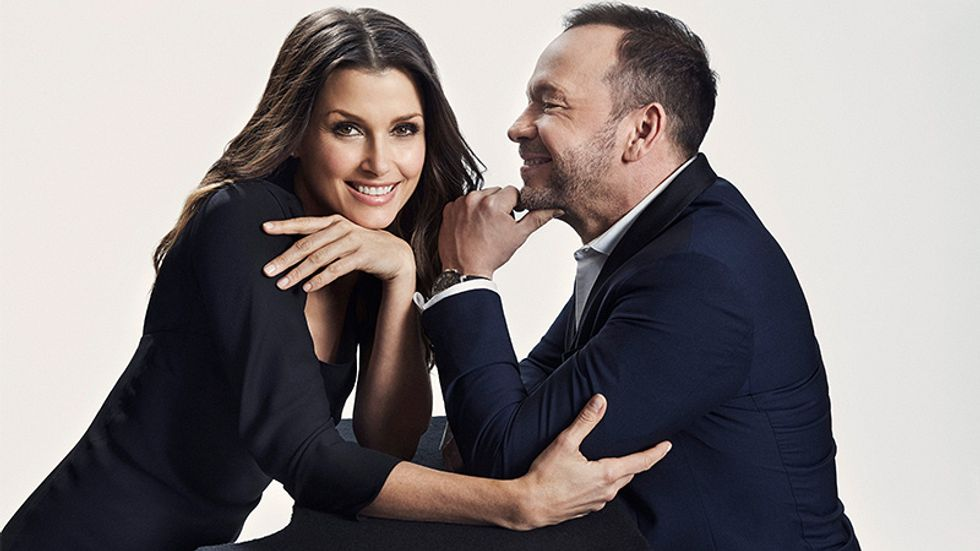 Bridget Moynahan and Donnie Wahlberg smiling in navy blue clothes
