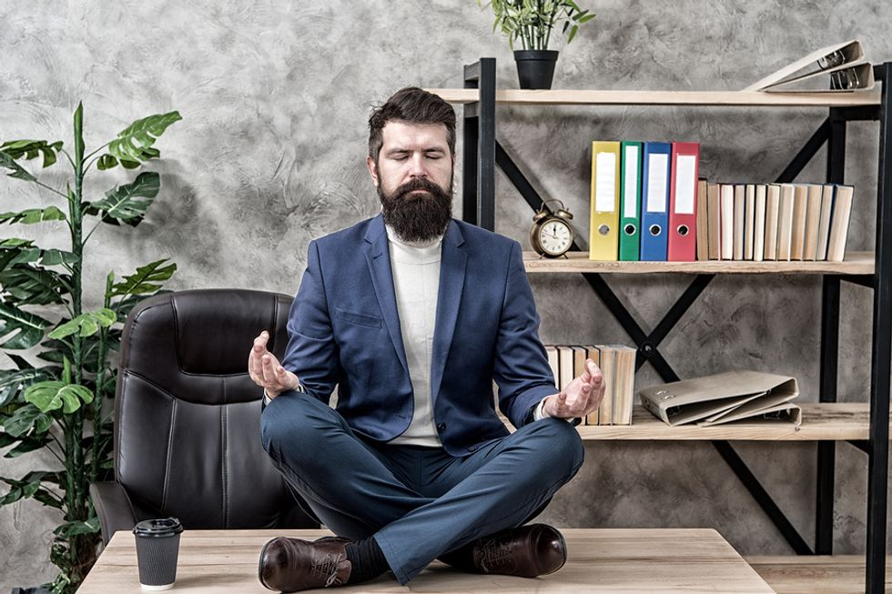 Professional man unplugging to prevent burnout