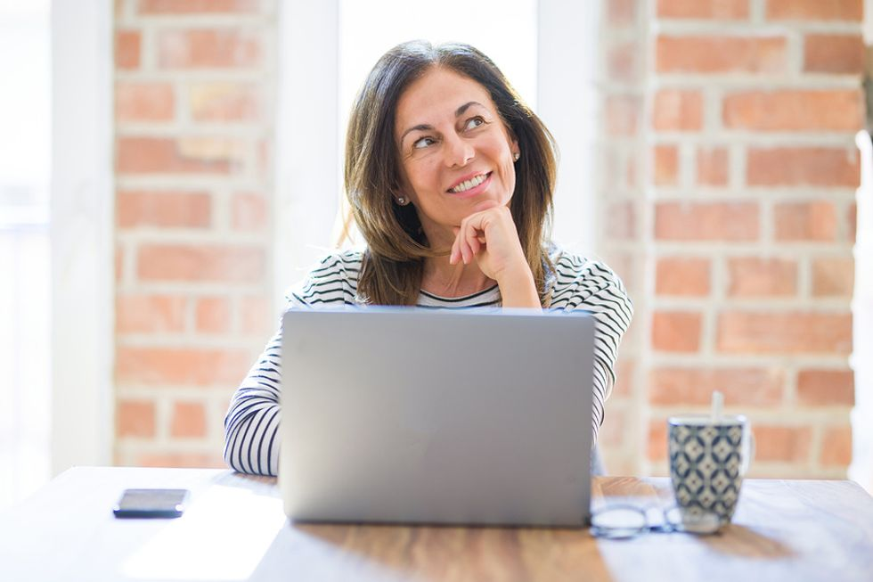 Woman thinking about her purpose at her job